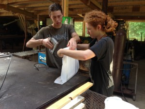 Gabriel Elkind (left) and Brenna Fitzpatrick make a silk screen printer.