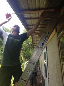 Stephen Whiting measures how wide the soffit will need to be on the north side of the Hab Lab. Photo by Clair Sprenger